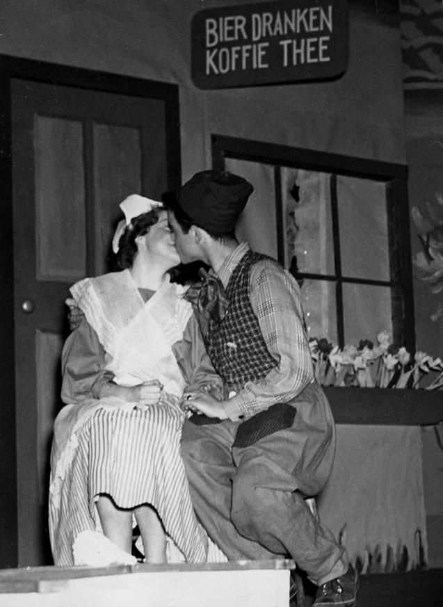 "Musical – ""Tulip Time"". Cast members Lou Rosse and Eleanor Mackenzie, kissing (1949.)"